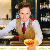 Headshot of Tom Hogan, Head Craftman at Anti:Dote bar in Farimont Hotel Singapore