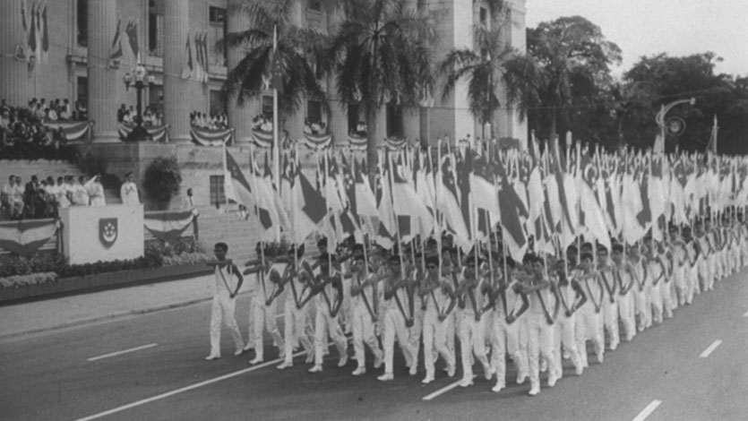 A group of soldiers marching in celebration of Singapore's Independence Day on 9 August 1965