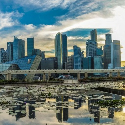 Sunset view of the Marina Bay skyline, reflected on the lotus pond outside the ArtScience museum™