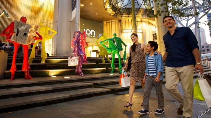 Family walking past ION facade