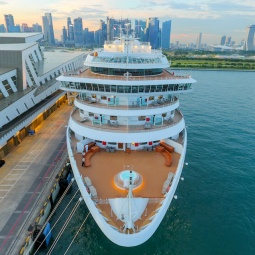 An aerial view of a cruise docked at Marina Bay Cruise Centre Singapore (MBCCS)