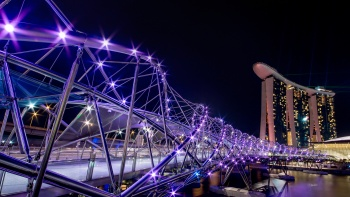 The lighted Helix bridge structure at night