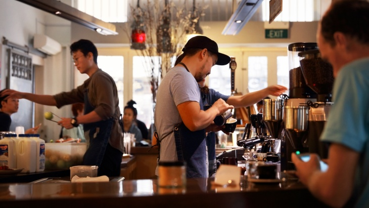 Busy baristas preparing coffee at Chye Seng Huat