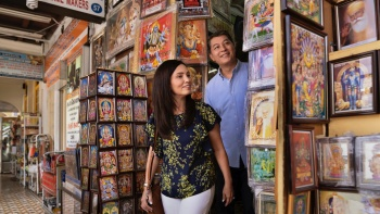Couple admiring artwork at a shop in Little India