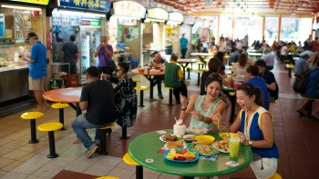 Two friends dining at Maxwell Hawker Centre