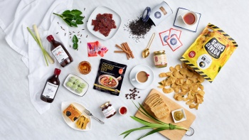 Flat lay image of Singaporean snacks and edible souvenirs.