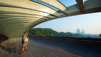 A couple at the Henderson Waves bridge looking at the scenery