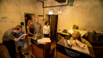 Group of visitors exploring the Battlebox museum in Fort Canning Hill