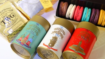 Close up shot of tea flavours by TWG with different flavoured macarons in background
