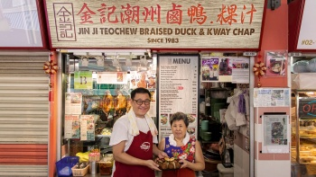 Owners outside the Jin Ji Teowchew Braised Duck And Kway Chap Store Facade, located at Chinatown Complex Food Centre