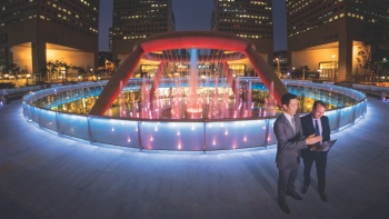 The Fountain of Wealth at Suntec City at night with established career men