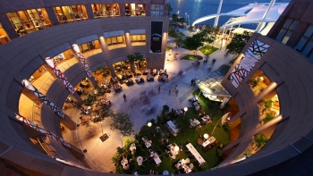 An aerial view of the exterior of Esplanade with people dining on the ground floor.