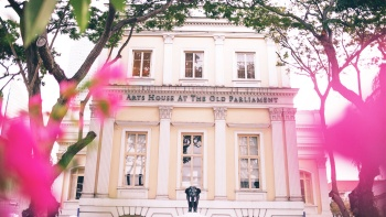 The Arts House exterior, with pink flowers framing façade