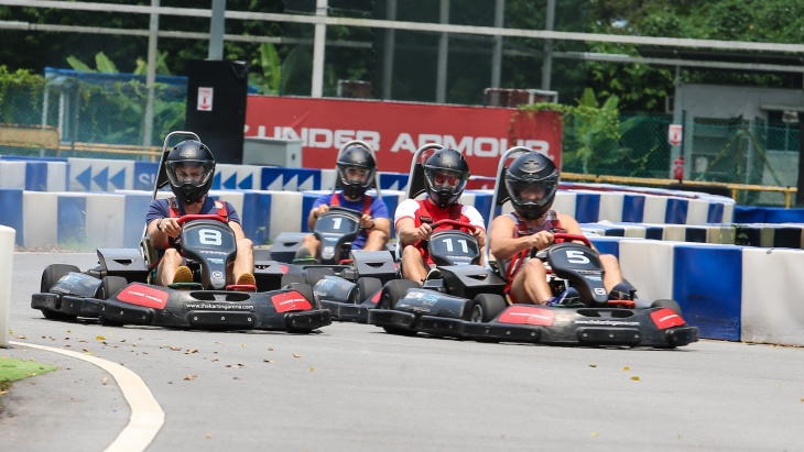 4 Racers swerving down the Karting Arena's track
