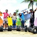 Tour participants on Segway scooters at Siloso Beach, Sentosa