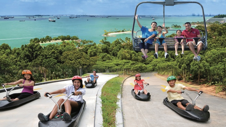 Skyline Luge, Skyride chairlift set against backdrop of Palawan Beach Sentosa