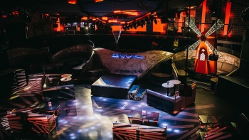 Movie-goers enjoying a non-conventional film screening under the stars.