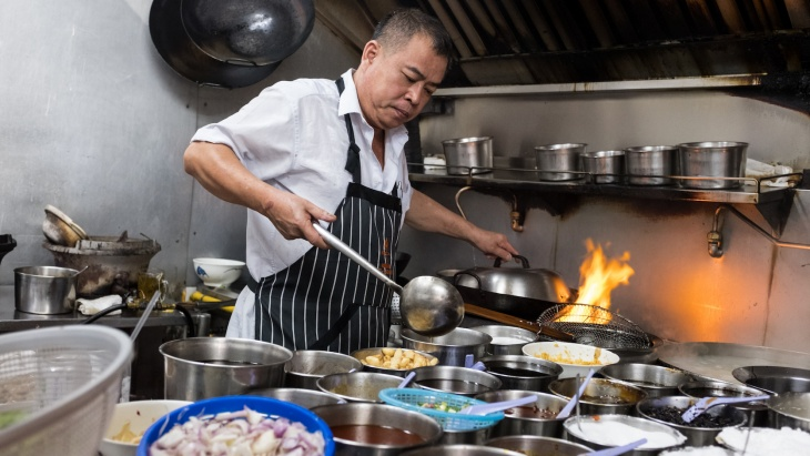 Chef wah Ah Suan preparing and cooking at Kok Sen restaurant