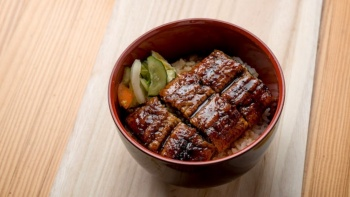 Delicious bowl of Unagi (Freshwater eel) with Japanese rice and pickles from Man Man