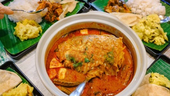 Closeup image of fish head curry at Muthus curry