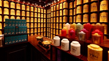 Rows of TWG tea containers on display.