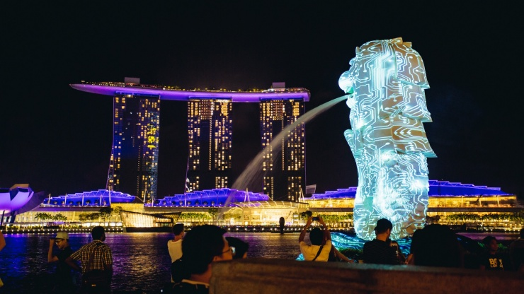 Glowing Merlion against Marina Bay Sands in the night