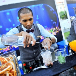 Bartender concocting a drink