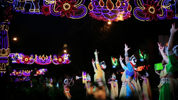 Ethnic Indian dancers on Little India's streets during Deepavali