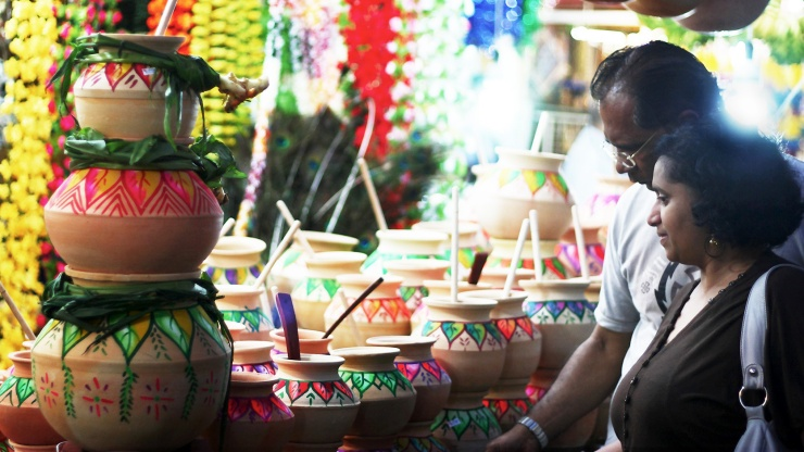 Couple shopping for ornaments during Pongal Festival