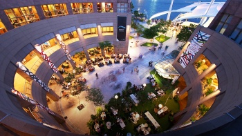 Aerial view of the dining area outside Esplanade – Theatres on the Bay in the evening