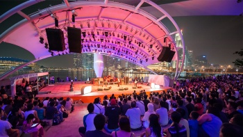 Audience watching a performance at the Outdoor Theatre at Esplanade – Theatres on the Bay