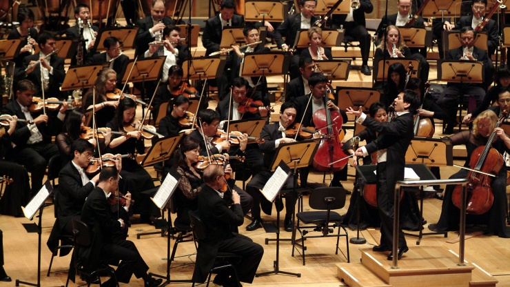 An orchestra performance at The Victoria Theatre and Concert Hall