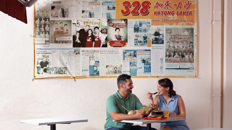 Couple enjoying a meal at 328 Katong Laksa