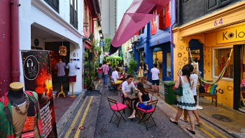 A scene of the colourful shophouses at Haji Lane, where customers are dining al-fresco