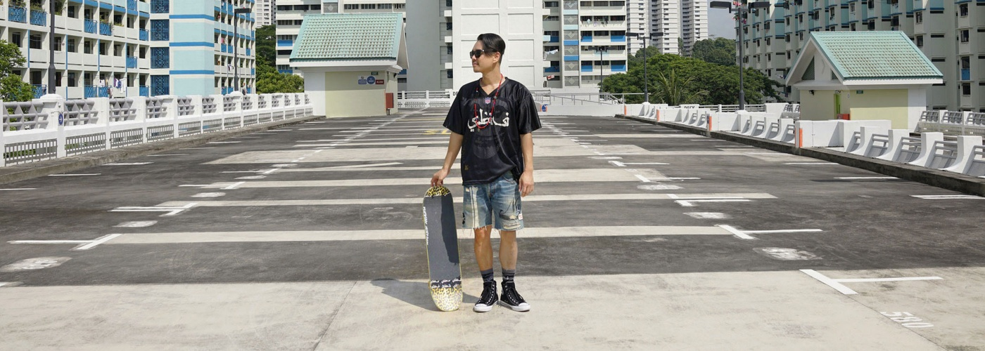 Mark Ong with a skateboard