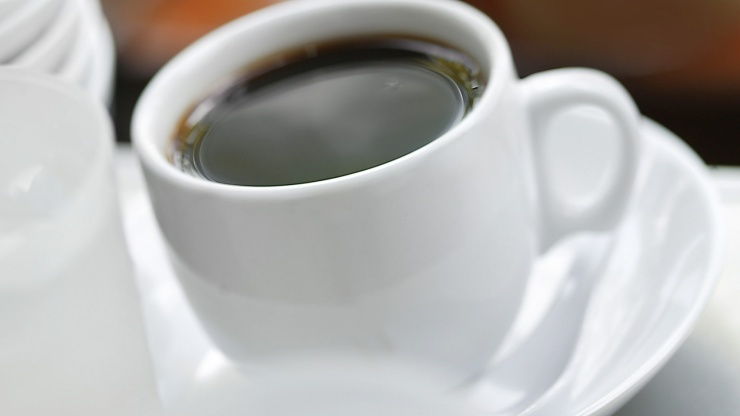Close up image of a hot cup of <i>kopi</i> (coffee)