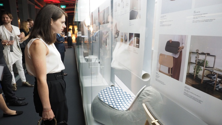 Person viewing exhibits at the Red Dot Design Museum Singapore