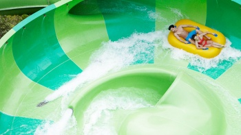 Couple on the Pipeline Plunge water ride at Adventure Cove Waterpark™