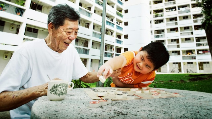 A boy and his grandfather playing chess
