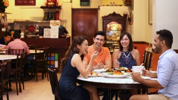 A group of established careers enjoying Peranakan cuisine at the oldest Peranakan restaurant in Singapore, Guan Hoe Soon.