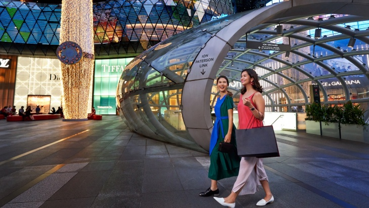 Ladies decked in local brands shopping outside ION Orchard
