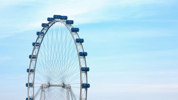 Half of Singapore Flyer against blue sky