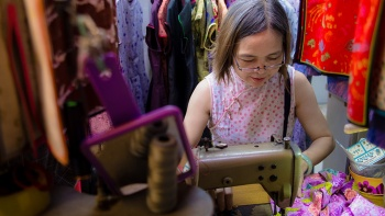 A seamstress at Golden Scissors Cheongsam located in People's Park Centre at Chinatown