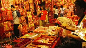 Stall in Chinatown selling red coloured items for Chinese New Year