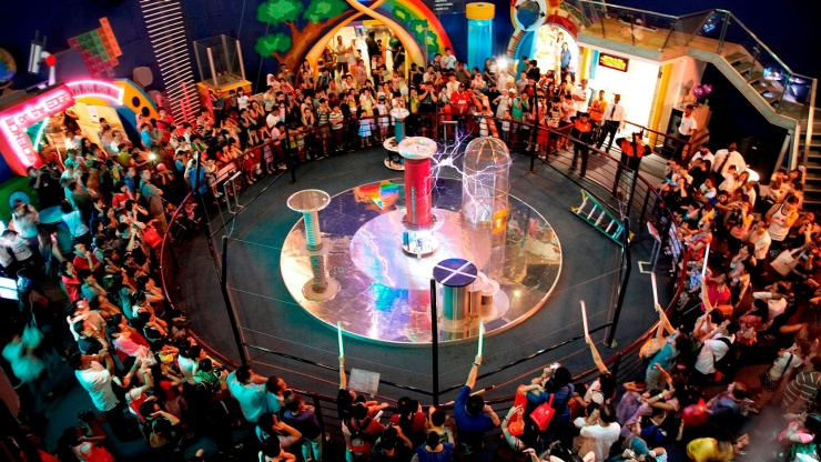 Wide shot of Tesla Coil at Science Centre Singapore showing audience its electric powers