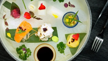 Vegetable sashimi on ice with quail egg shooter glass from Joie by Dozo