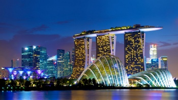 Night view of Marina Bay Sands, and Cloud Forest and Flower Dome conservatories, viewed from Marina Bay East Gardens