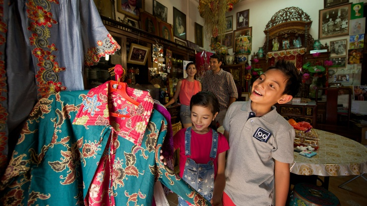 Family in shop with Peranakan memorabilia