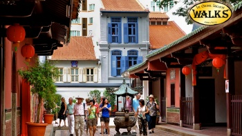 Group of visitors walking along Chinatown district, the oldest Hokkien-Chinese temple in Singapore