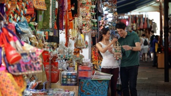 Couple browsing souvenirs along the Little India street stall